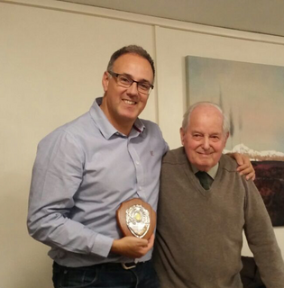 Geoff Lawrence presenting Adrian England with an award